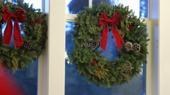 Christmas wreath hanging on window Stock Footage