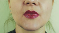 Woman with red pomade show air kiss in camera. Mouth. Play the ape. Face Stock Footage