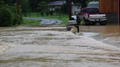 Flood Waters Rapidly Flow over Road with Isolated Mailbox Stock Footage