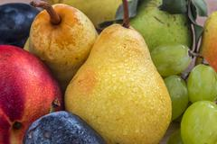 A few fresh bio pears, grapes, plums and nectarine Stock Photos