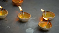 Tiny, Handmade Candles Burn on a Buddhist Altar in Singapore Stock Footage