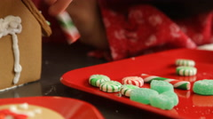 Decorating gingerbread house for Christmas Stock Footage