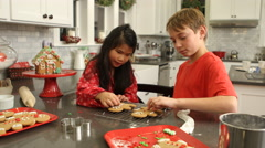 Decorating gingerbread men for Christmas Stock Footage