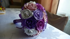 Bridal bouquet of blue, video purple and white roses on a table Stock Footage