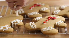 Frosting gingerbread cookies, closeup Stock Footage