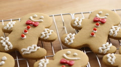 Closeup of homemade gingerbread cookies on cooling racks Stock Footage