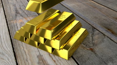 Placing gold bars Stock Footage