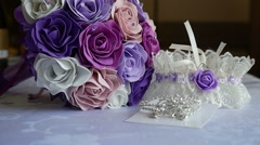 Bridal bouquet of blue, purple video and white roses on a table Stock Footage