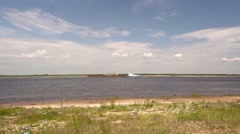 Barge near the Far Bank of the Volga River in Russia Stock Footage