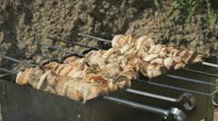 Kebabs are roasted on the metal skewers on coals Stock Footage