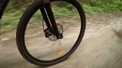 Mountain Bike Wheel Rolling over Country Road Stock Footage