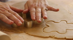 Cutting out gingerbread men cookies Stock Footage