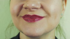 Woman with red pomade smile pronounce words in camera. Mouth. Teeth. Air kiss Stock Footage