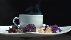 Cup of floral tea with flowers rotation isolated Stock Footage