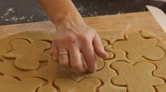 Placing gingerbread cookies on cookie sheet Stock Footage