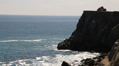 Rocky cliffs and Pacific Ocean during the day Stock Footage