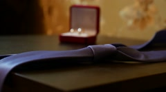 Video wedding rings and a blue tie on the table Stock Footage