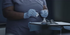 Mid-section of nurse giving a injection to doctor Stock Footage