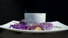 Adding sugar to cup of tea with flowers rotating Stock Footage
