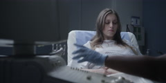 Doctor performing an ultrasound scan on pregnant woman Stock Footage
