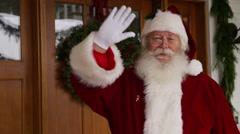 Santa Claus waving by front door Stock Footage