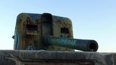 Old coast artillery with graffiti - slowmotion 120 fps Stock Footage