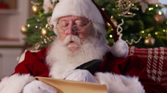 Closeup, Santa Claus writing on list Stock Footage