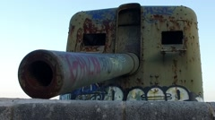 Old coast artillery with graffiti - slowmotion Stock Footage