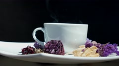 Cup of tea with flowers rotating Stock Footage