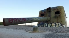 Old coast artillery with graffiti Stock Footage