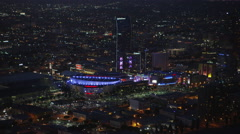 Aerial view of Staples Center, Los Angeles at night Stock Footage
