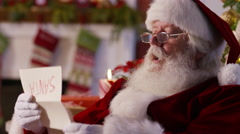Santa Claus reading letter from child, closeup Stock Footage