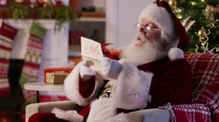 Santa Claus reading letter from child Stock Footage