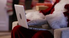 Santa Claus using laptop, closeup Stock Footage
