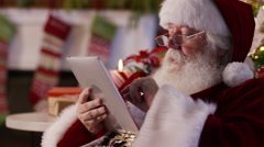 Santa Claus using digital tablet Stock Footage