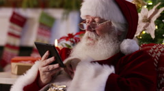 Santa Claus using digital tablet, closeup Stock Footage