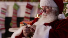 Santa Claus using cell phone, closeup Stock Footage