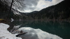 Alpine Lake Malaya Ritsa in winter under gloomy clouds, Abkhazia. Full HD Stock Footage
