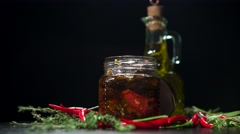 Olive oil, baked tomatoes and chilli rotation Stock Footage