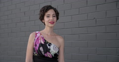 Beautiful mixed race woman after makeover by dark brick wall 4K Stock Footage