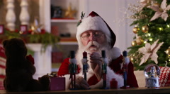 Santa Claus painting toys in workshop Stock Footage
