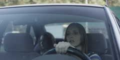 Mother driving car with daughter Stock Footage