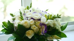 Small bouquet video of white roses on the window Stock Footage