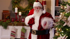 "Santa Claus waves and says ""Merry Christmas"" Stock Footage"