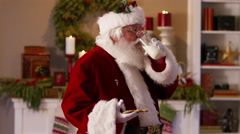Santa Claus has some milk and cookies Stock Footage