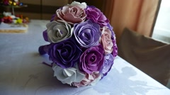 Video bridal bouquet of blue, purple and white roses on a table Stock Footage