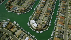 Aerial helicopter view of River lined homes San Francisco City Bay area Stock Footage