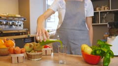 Green smoothie woman making vegetable smoothies with blender Stock Footage