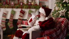 Santa Claus gives present to young girl Stock Footage