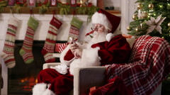 Santa Claus using cell phone Stock Footage